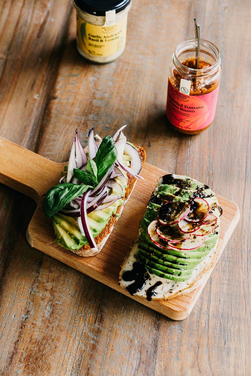 Avocado Toast with Sun-Dried Tomato Pesto Rosso, Red Onion, and Fresh Basil — Delicious & Sons