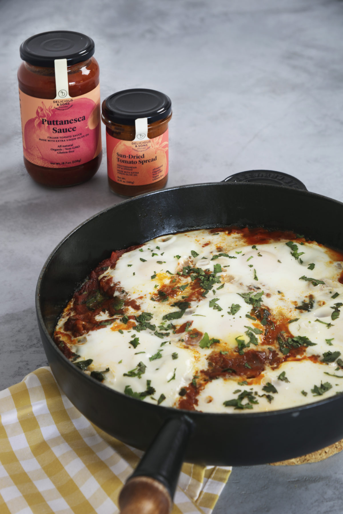Shakshuka with Spinach and Puttanesca Sauce and Sun-Dried Tomato Spread by Alberto Rey — Delicious & Sons