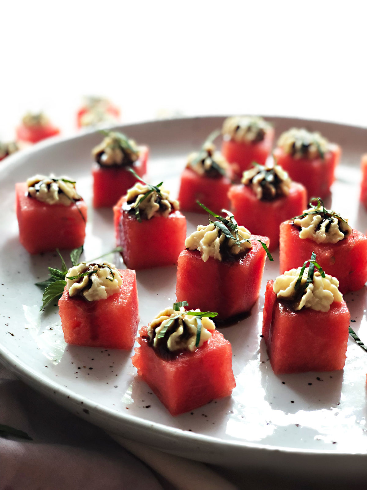 Watermelon Bites with Miso, Pine Nuts, and White Truffle Balsamic Glaze by Marisa Ford — Delicious & Sons