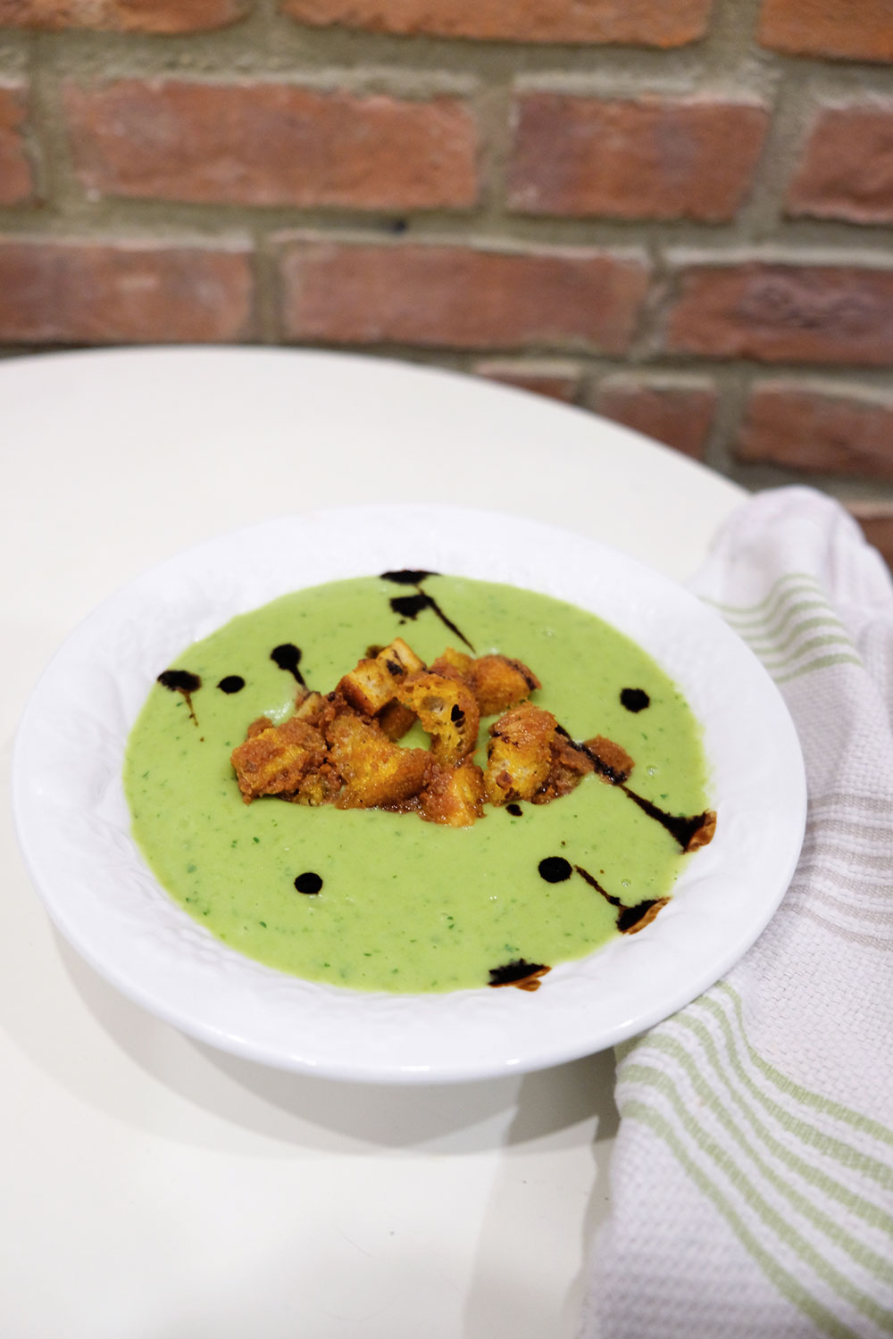 Split-Pea Soup with White Truffle Balsamic Glaze and Sun-dried Tomato Croutons by Courtney Zoffness — Delicious & Sons